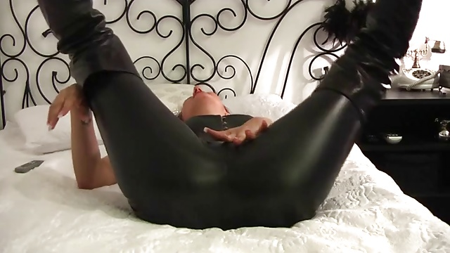 Hot bitch in leather leggings touching herself up